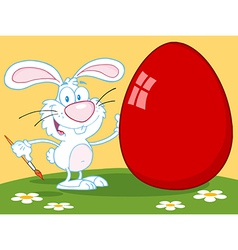 Happy rabbit painting red easter egg outdoors vector