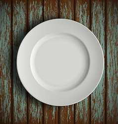White plate on old wooden table vector