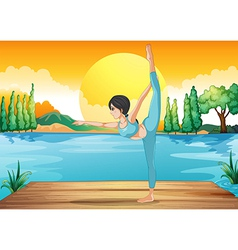 A girl performing yoga along the river in a sunset vector