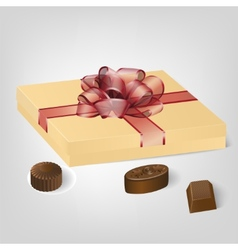 Gold gift box of chocolate candies vector