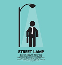 Businessman walking under street lamp vector