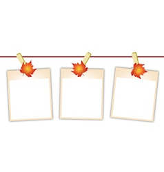 Blank photos with maple leaves on clothesline vector