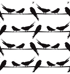 A silhouette of birds on a wire vector