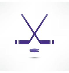 Hockey stick and puck icon vector