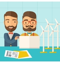 Workers using laptop with windmills vector