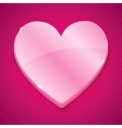 Glossy plastic heart on pink background vector