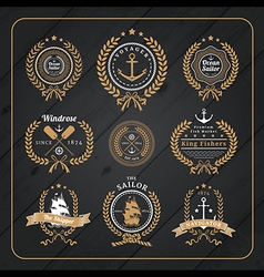 Vintage nautical wreath labels set on dark wood vector
