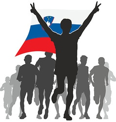 Athlete with the slovenia flag at the finish vector