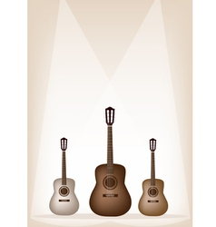 Three beautiful guitar on brown stage background vector