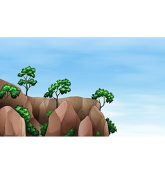 A cliff with trees vector