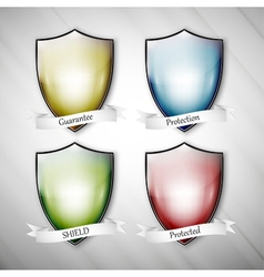 Empty isolated colored shields on dirty gray vector