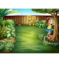 A little girl studying the plants in the garden vector