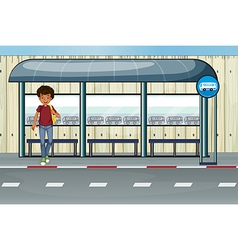 A boy at the bus stop vector