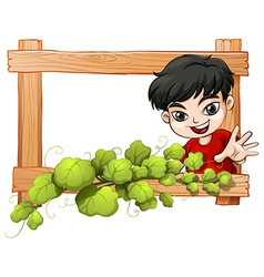 A frame with a plant and a boy vector