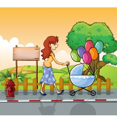 A mother strolling with a stroller vector