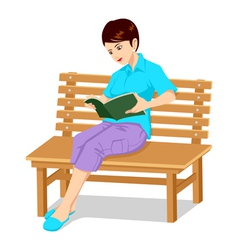 A girl reading a book vector