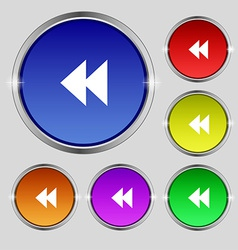 Rewind icon sign round symbol on bright colourful vector