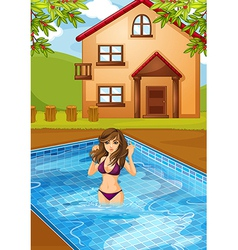 A sexy girl at the swimming pool vector