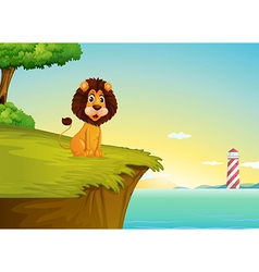 A lion sitting at the cliff overlooking the tower vector