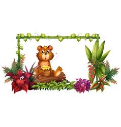 A bear above a trunk in the garden vector
