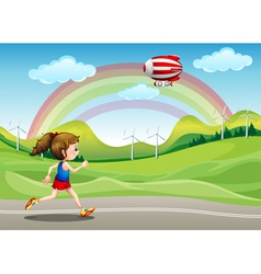 A girl running in the road and an airship above vector