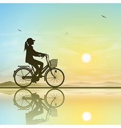 Girl on a bicycle vector