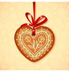Gingerbread heart on red ribbon vector