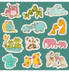 Baby and mommy animal set on paper tags vector