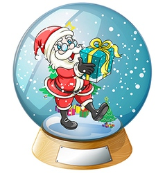 Santa claus holding a gift inside the snow ball vector