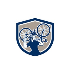 Bicycle mechanic carry bike shield retro vector