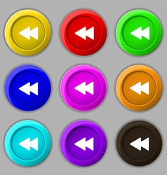 Rewind icon sign symbol on nine round colourful vector