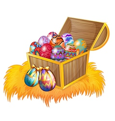 A wooden box with easter eggs vector