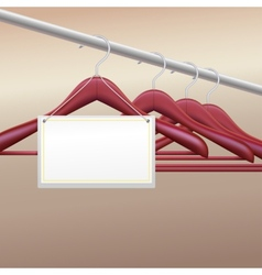 Wooden hangers with label vector