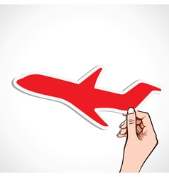 Red airplane sticker in hand vector