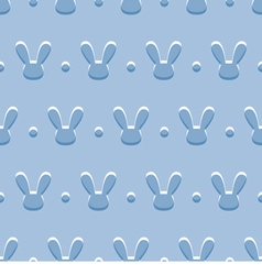 Seamless blue background with rabbits vector