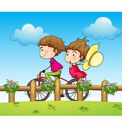 A couple riding a bicycle vector
