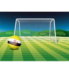 A soccer ball with the flag of brunei vector