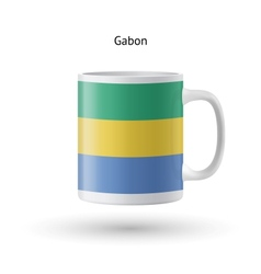 Gabon flag souvenir mug on white background vector