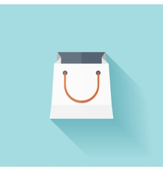 Flat shopping bag icon vector