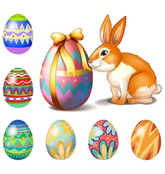 Seven easter eggs and a bunny vector