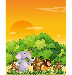 A group of animals walking at the forest vector
