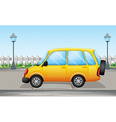 A yellow van in the street vector