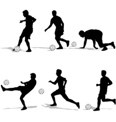Set silhouettes of soccer players with the ball vector