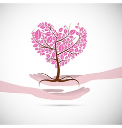 Heart shaped abstract pink tree in human hands vector