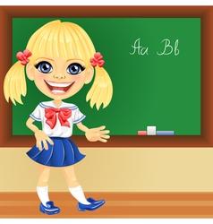 Smiling schoolgirl near blackboard vector