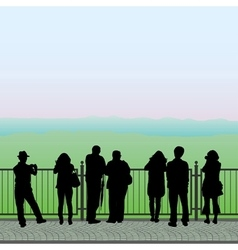 Silhouettes of people on the observation deck vector