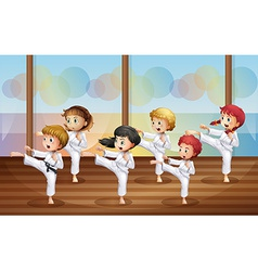 Kids practicing karate vector