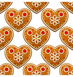 Gingerbread cookies seamless pattern with heart vector