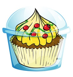 A cupcake inside the container vector