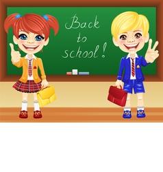Happy schoolchildren girl and boy near blackboard vector